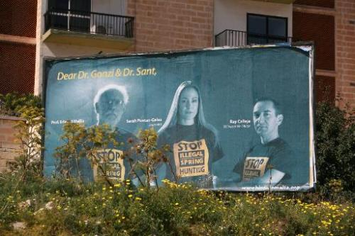 A billboard encouraging government to abolish spring hunting in Malta on March 8, 2008