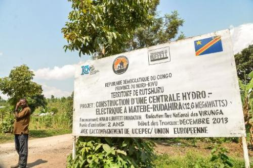 A board advertising a hydroelectric project in the Virunga National Park is seen on June 17, 2014 in Matebe, some 75 kms north o