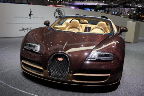 A Bugatti car is is displayed at the group's stand during the press day of the Geneva Motor Show in Geneva, on March 5, 2014