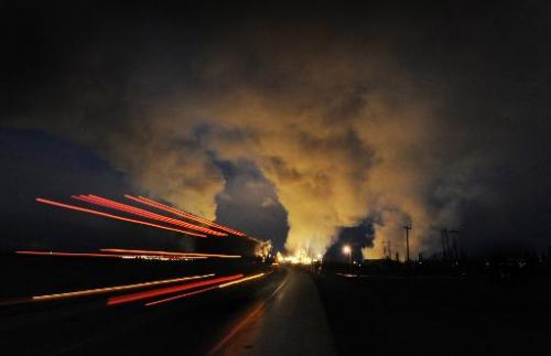 A bus carrying workers heads towards the Syncrude oil sands extraction facility in Alberta Province, Canada on October 22, 2009