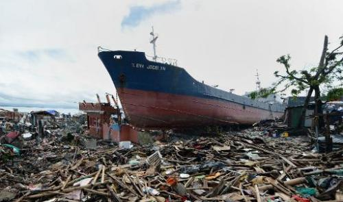 A cargo ship swept ashore at the height of Super Typhoon Haiyan still rests amongst debris and destroyed houses in Tacloban, Phi