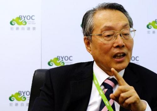 Acer's founder Stan Shih speaks during an interview with AFP in New Taipei City on June 5, 2014