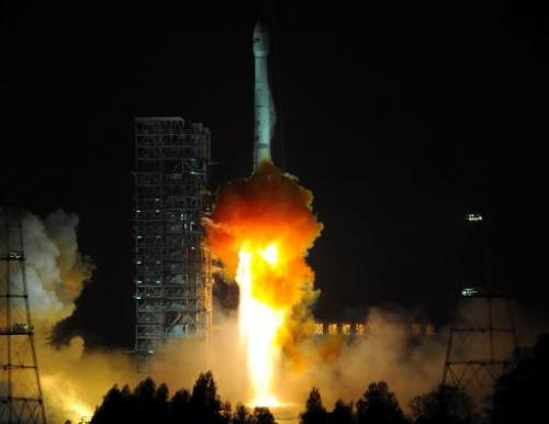 A Chinese Long March-3B carrier rocket blasts off from the Xichang satellite launch centre in Sichuan, China on December 21, 201