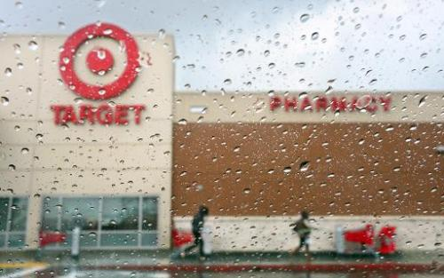 A couple of shoppers leave a Target store on a rainy afternoon in Alhambra, California on December 19, 2013