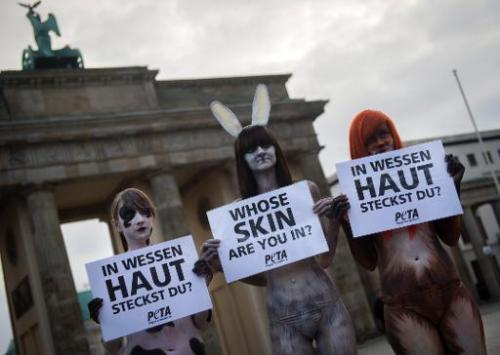 Activists from People for the Ethical Treatment of Animals (PETA), wearing body paint that looks like animal fur, protest at the