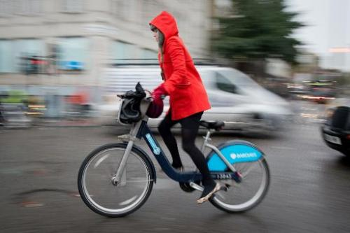 A cyclist rides on a Boris Bike in central London on November 20, 2013
