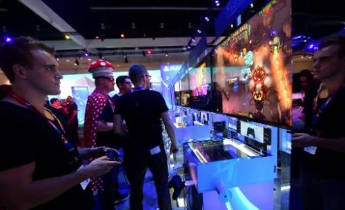 "A gaming fan plays ""Jamestown"" on a PlayStation 4 console at the E3 video game show in Los Angeles on June 10, 2014"