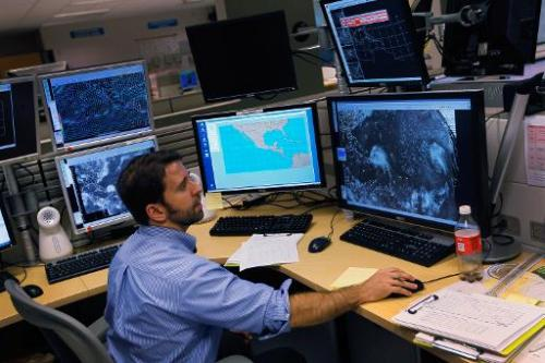 A hurricane forcaster studies computer models as he tracks Hurricane Irene at the National Hurricane Center on August 22, 2011 i