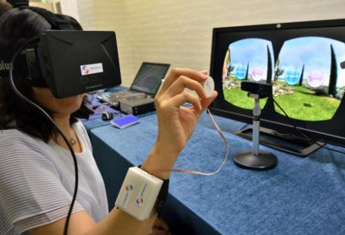 "A journalist tries to use ""3D-Haptics Technology"", at a press preview in Tsukuba, suburban Tokyo on September 1, 2014"