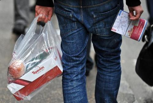 A man holds a plastic bag in Rome on December 31, 2010