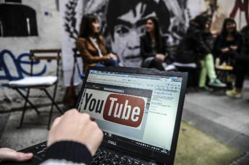 A man looks at the YouTube site on a laptop in Istanbul on March 27, 2014