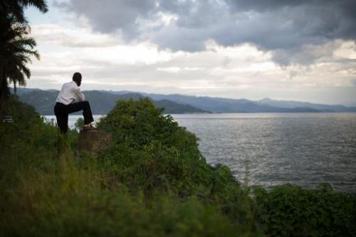A man looks towards the hills of Rwanda on the eastern edge of Lake Kivu from the Democratic Republic of the Congo's eastern cit