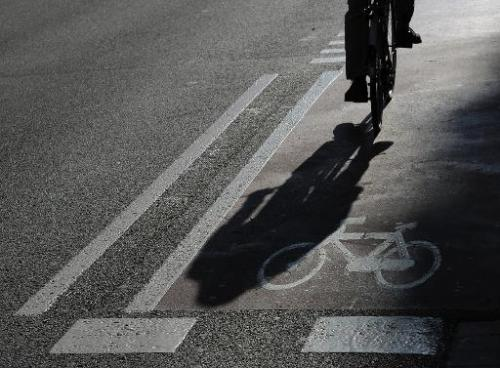 A man rides a bike lane in central Barcelona on February 20, 2013