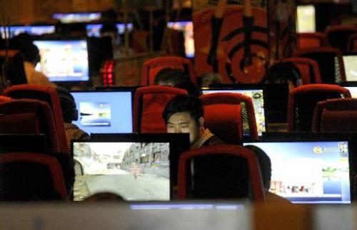 A man surfs the internet at a cafe in Beijing on May 12, 2011