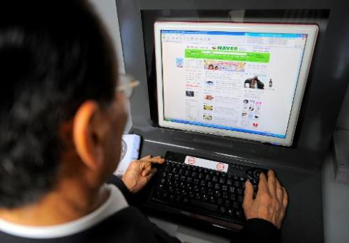 A man uses the home-grown Naver search engine through a public computer set up at a subway station in Seoul on May 26, 2008