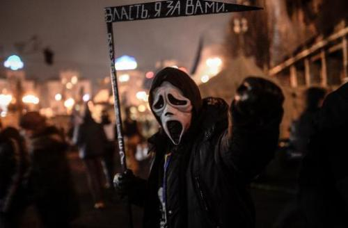 A man with a mask at Independence Square in Kiev on February 24, 2014
