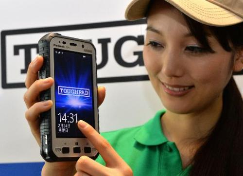 """A model displays a new Panasonic """"Toughpad FZ-X1"""" heavy duty tablet in Tokyo on February 24, 2014"""