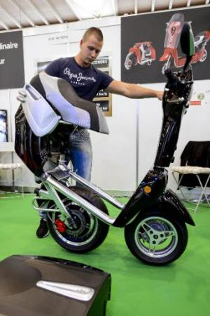 An exhibitor presents an electric folding scooter, created by French inventor Fabrice Marion, during the opening day of the Inte