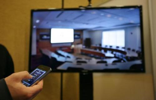 An iPhone and iPad app that enables iPhone and iPad to function as a remote controller for home electronics such as TV, is seen