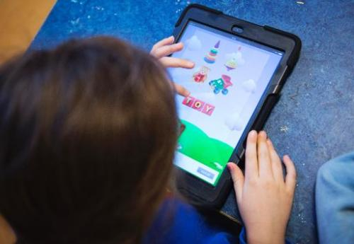A Nnursery school pupil works with an iPads on March 3, 2014 in Stockholm