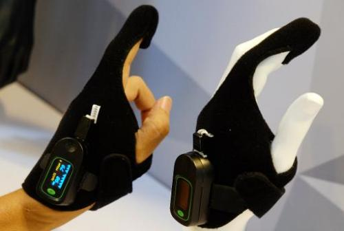 An Oximetry glove, designed by Taiwan Textile Research Institute, is displayed at the Computex tech show in Taipei on June 4, 20