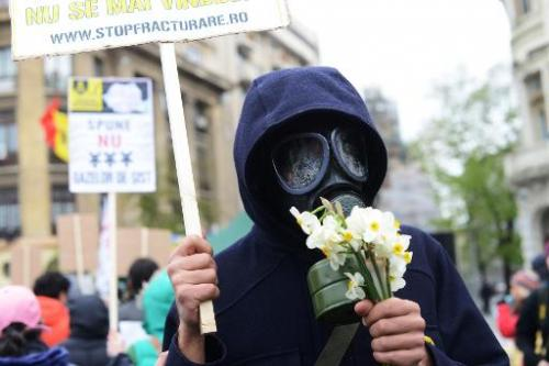 A protester against shale gas drilling in Bucharest, Romania, on April 6, 2014