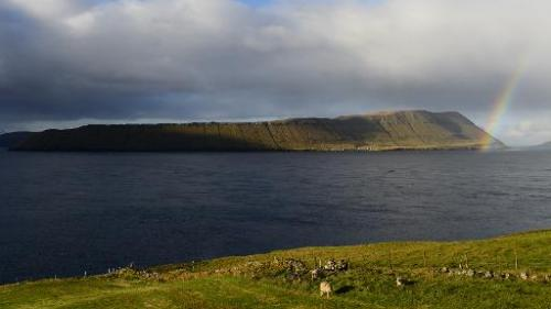 A rainbow appears above the Hestur island on October 16, 2012, Faroe Islands