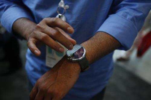 A representative gives a product demonstration of a Motorola Moto 360 watch during the Google I/O Developers Conference at Mosco