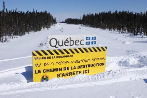 A sign erected in 2010 in the middle of a road in Canada's Broadback Valley by trappers from the James Bay Cree Indian nation an
