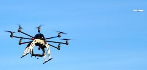 A small drone hovers in the sky during a meet-up of the DC Area Drone User Group on February 1, 2014