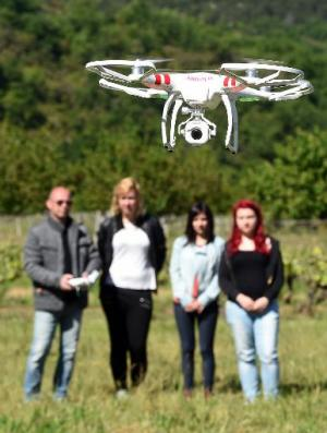 A teacher flies a drone as part of a class on aerial photography to high school students  on May 15, 2014 in France