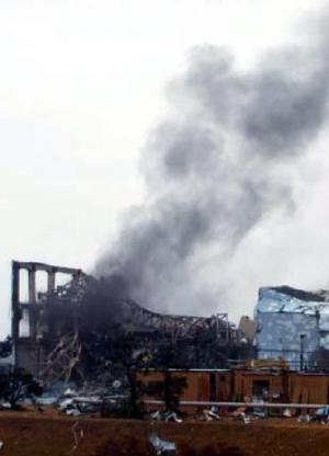 A TEPCO picture released on March 21, 2011 shows black smoke rising from reactor number three at the crippled Fukushima nuclear