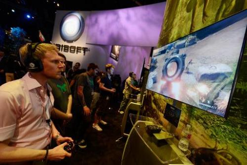 "Attendees play the video game ""Far Cry"" in the Ubisoft booth at the E3 gaming conference on June 5, 2012 in Los Angele"