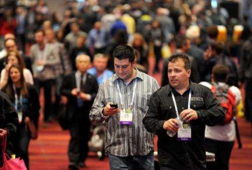 Attendees walk around the 2014 International CES at the Las Vegas Convention Center on January 7, 2014 in Las Vegas, Nevada