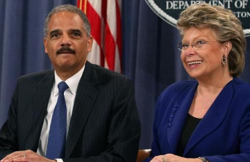 Attorney General Eric Holder (L), and EU Principal Vice-President Commissioner for Justice, Viviane Reding, participate in a mee