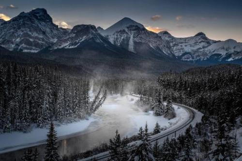 A view of the frozen Bow River and the Canadian Pacific Railway, seen at Banff National park near Lake Louise, Canada, on Decemb