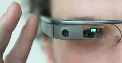 "A visitor of the ""NEXT Berlin"" conference tries out the Google Glass on April 24, 2013 in Berlin"