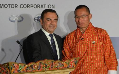 Carlos Ghosn (left) with Bhutanese Prime Minister Tshering Tobgay at a press conference in Thimphu on February 21, 2014