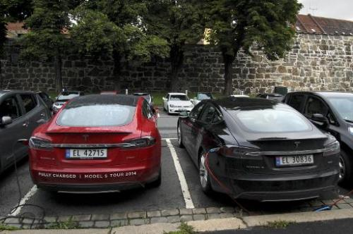 Cars are seen charging in free parking spaces for electric cars in central Oslo on August 19, 2014