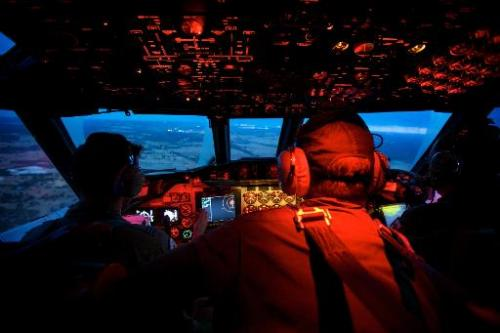 Crew members on board an RAAF AP-3C Orion during a search mission for missing flight MH370 before, March 24, 2014