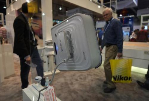 Ecovacs presents Winbot, a window cleaning robot, during the 2014 International CES at the Las Vegas Convention Center on Januar