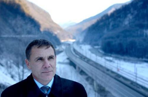 Environmental Watch ecology group activist Yevgeny Vitishko, standx in front of the new road between Adler and Krasnaya Polyana