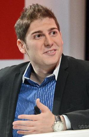 Facebook co-founder Eduardo Saverin speaks during the Wall Street Journal Unleashing Innovation executive conference held at Cap