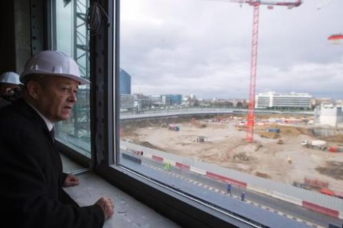 French Defence minister Jean-Yves Le Drian visits the construction site of the new French Defence minister on January 17, 2014 i