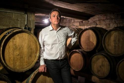French winemaker Emmanuel Giboulot poses in his domain's wine cellar on February 24, 2014 in Beaune