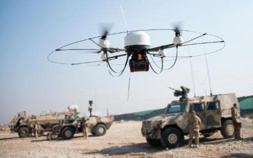 German Bundeswehr soldiers fly a Mikado drone at Camp Marmal in Mazar-e-Sharif, Afghanistan, on December 23, 2013