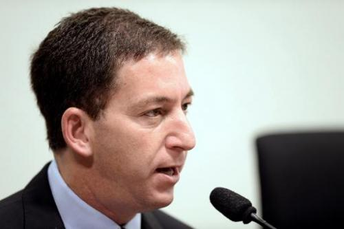 Glenn Greenwald testifies in Brasilia on October 9, 2013 before the investigative committee of the Senate that examines charges