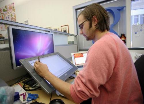 Google Doodle Creative Lead Ryan Germick works on an illustration at the Google headquarters in Mountain View, California, on Se