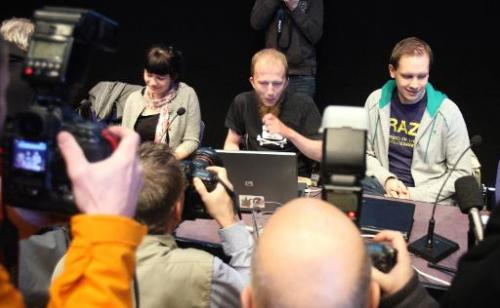 Gottfrid Svartholm Varg (C) and Peter Sundin, (R) from The Pirate Bay, an online piracy site meet the press in Stockholm, Sweden