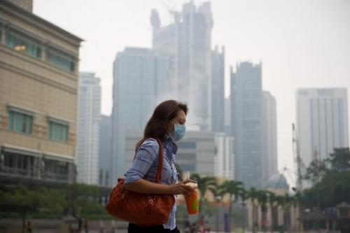 Haze shrouds Kuala Lumpur and surrounding areas, causing 'unhealthy' air quality due to fires from a drought